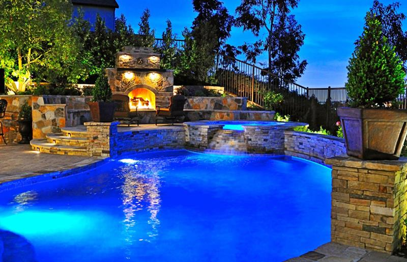 These amazing in-ground pools are not only for design and landscaping purposes: they are also for relaxation, too. [Image Credit: Home Epiphany]
